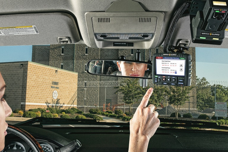 An officer uses Record-After-the-Fact on her 4RE in-car video system.