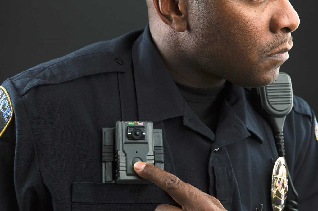 An officer uses body-worn cameras.