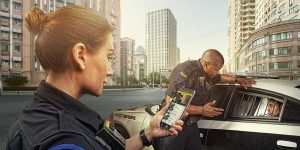 Officers use body worn cameras through a smartphone.