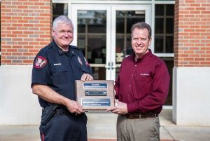 WatchGuard presents a commemorative plaque.